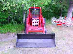 Tractor and haying equipment for sale.