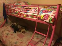 Pink triple bunk beds