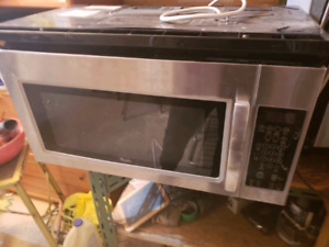 Microwave with hood fan for the range.