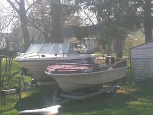 14 ft  Red Cutter boat with a Chrysler 45hp motor