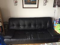 Black leather couch can turn into bed (price negotiable)