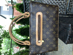 Vintage 70 year Louie Vuitton hand bag and wallet