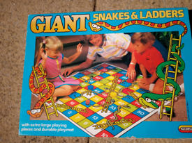 Kid's game. Giant Snakes and Ladders
