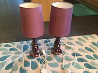 Two Next plum coloured bedside lamps