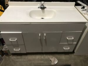 white bathroom vanity with sink and tap