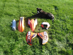 Full set of KTM plastics + stock muffler.