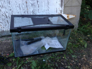 10 Gallon reptile tank with heat map and accessory.