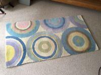 100% wool rug with circular pattern