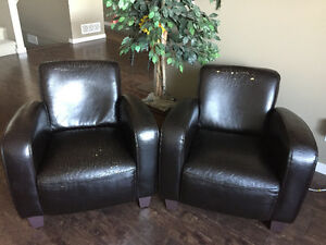 2 brown living room chairs