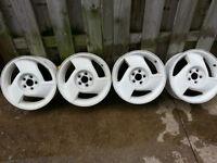 4 Pontiac stock white rims