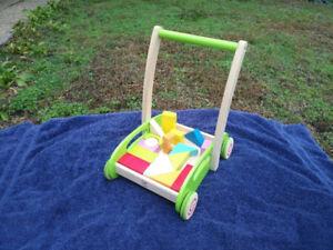 Kids push trolley with shape blocks