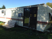 31 ft Prowler trailer Fix up or hunting camp