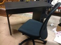 Black desk and office chair