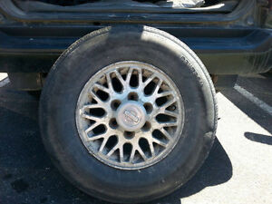 4 P235/75r15 Tires with Rims