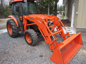 Kubota L-3540 4X4 cab and loader, and m-6040 and L-3130