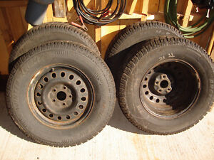 For Sale Four 17 inch Studded Winter Tires and Steel Rims