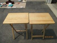 Two small folded wood tables