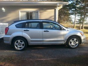 2008 dodge caliber 4 door silver in color