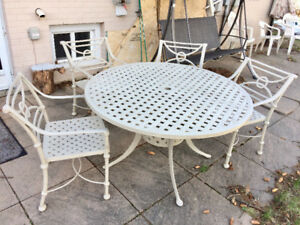 Glass patio table $50, Swaying chair $120,Metal patio set$750,