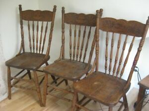 Three antique press back wooden chairs