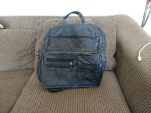 Black leather laptop/carry all backpack. New