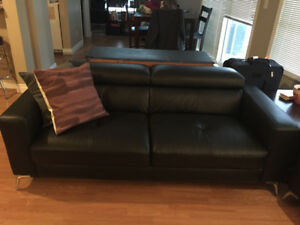 Moving away...Selling black leather sofa and love seat!