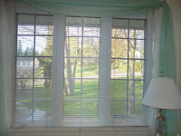 Beautiful large window with Metal Blind and Curtain.