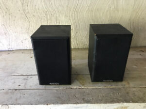 Paradigm speakers with wall mounts.