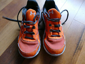 Used Under Armour Micro G youth size 4 running shoes.