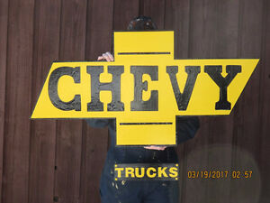 CHEVY TRUCKS SIGN.