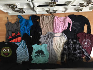 14 small/extra small shirts and 2 small/xs dresses