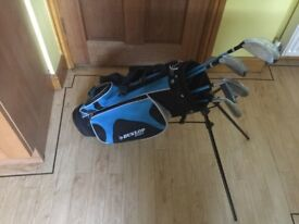 Junior golf club set by Dunlop and trolley and 5 golf clubs