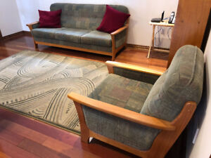 Teak sofa and chair. Also included are rug and bookshelf