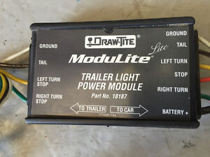 Powered trailer light module converter