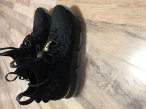 Lebron 16's black and gold basketball shoes