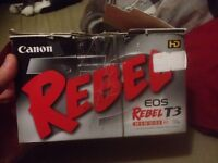 Brand new in box canon rebel t3 eos with lens