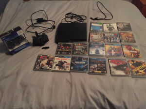Playstation 3 + 2 Controllers + Dock + Games