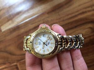 Gold women's ESQ esquire watch made by Movado