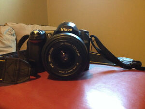 Nikon D50 plus 2 lenses and universal charger