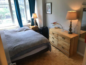 Bright bedroom in 2 bedroom - subway, near downtown core -female