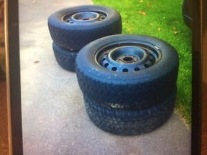 Set of four 215/65/16 studded winter tires on rims