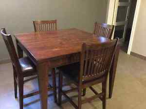 SOLID WOOD TABLE AND FOUR COMFORTABLE CHAIRS