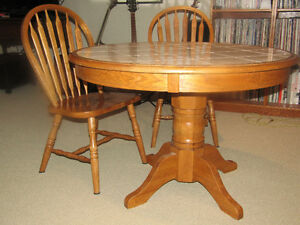 Good Quality Solid Oak Table and 4 Chairs (only 2 shown)