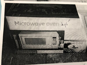 Near new GE microwave in box