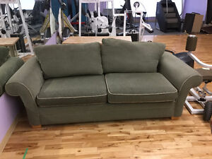 Olive/Green Couch with hide a bed