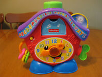 FISHER PRICE LAUGH AND LEARN PEEK A BOO MUSICAL CLOCK