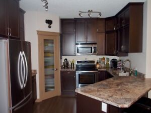 DEC. 1 - FURNISHED 2 BED/2 BATH TOP-FLOOR CONDO IN SHER. PK.