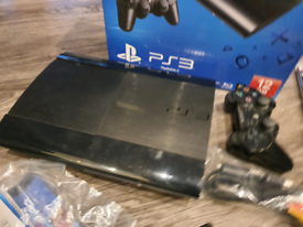 Sony PS3 ultra slim with games and controller