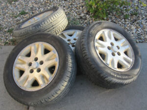 Nokian 225/60R16 - 2 tires in great condition and 4 rims