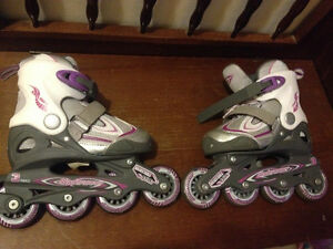 Mint condition rollerblades adjustable to 4 sizes